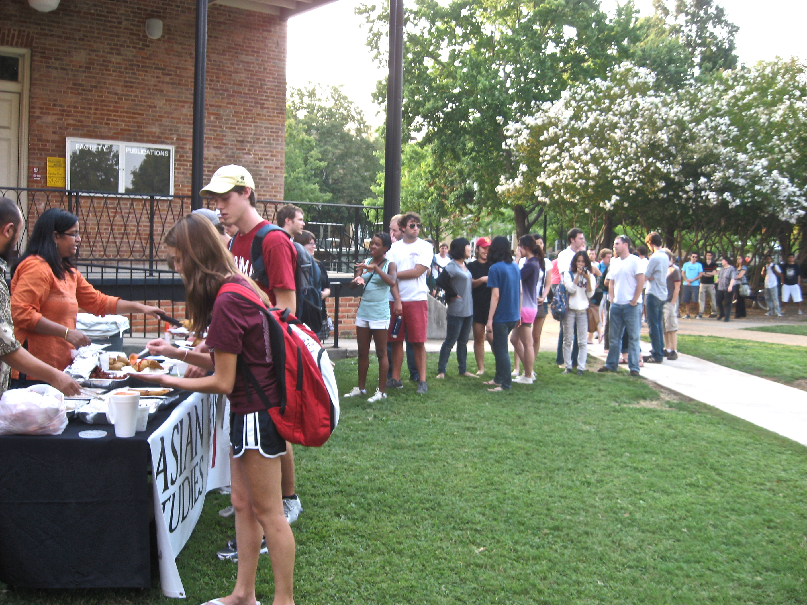students lined up for food outside Manly Hall
