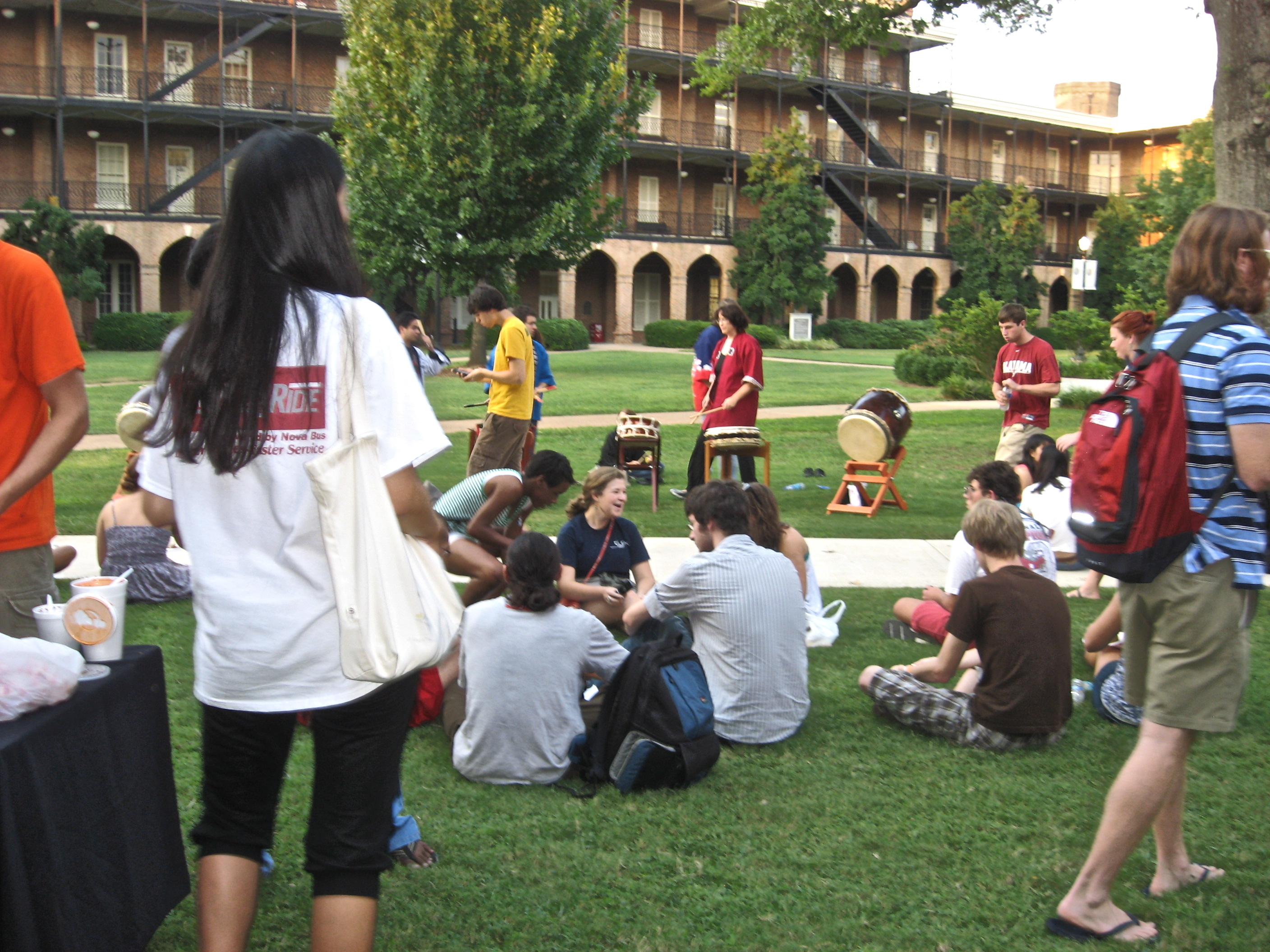 students sitting together in Woods Quad
