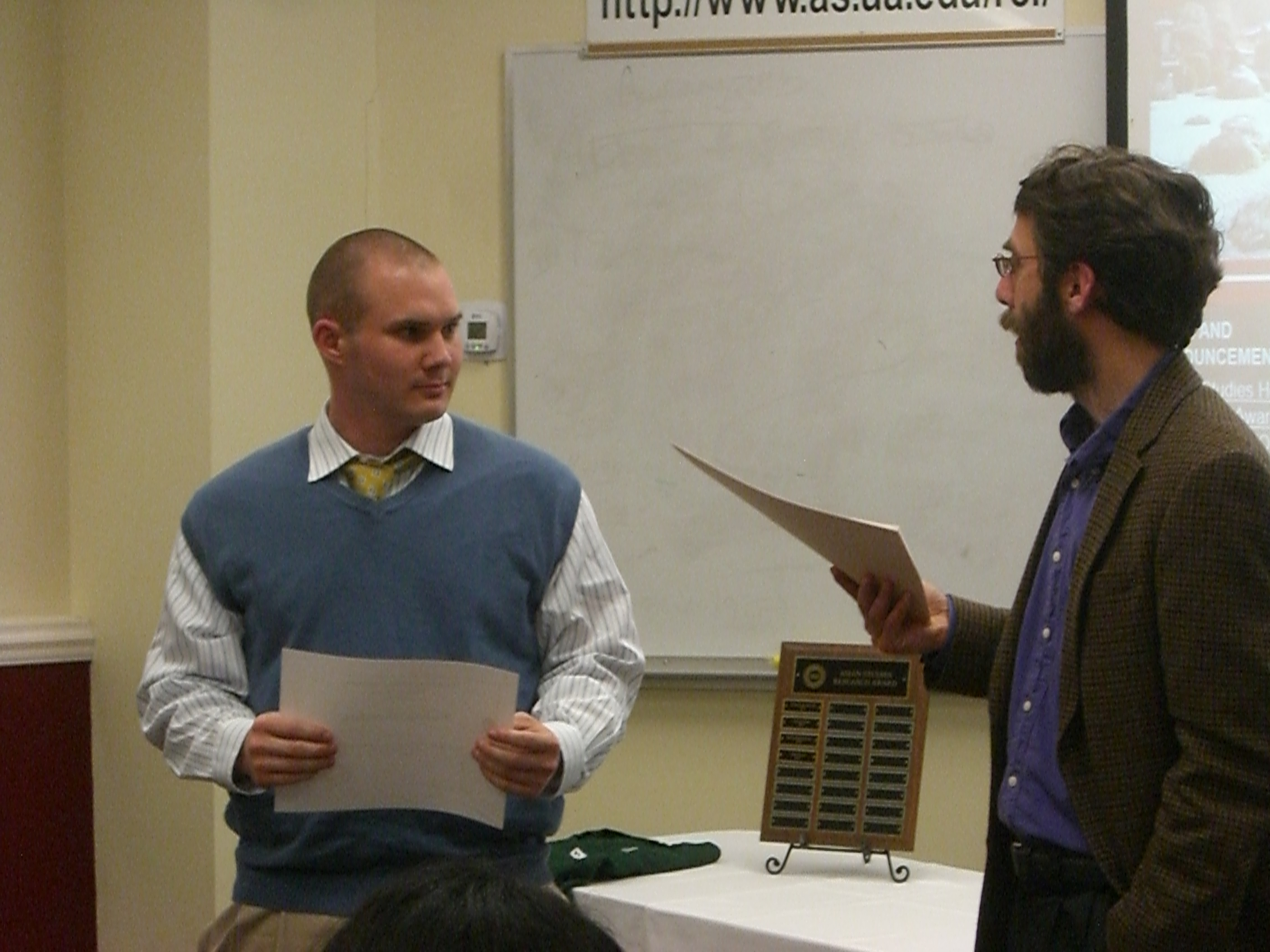 Nicholas Crenshaw receiving the Outstanding Student Award