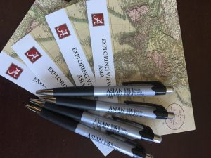 Pens and maps with the Asian Studies logo