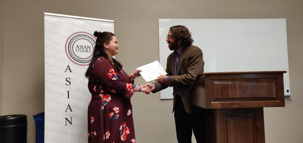 Emily Delozier receiving Asian Studies award